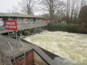 The River Thames in full flood, Abingdon Lock and weir.